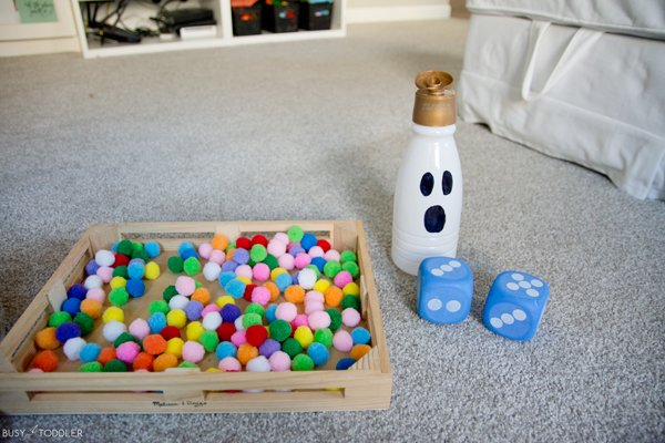 Halloween activity with a creamer bottle, pom poms and dice