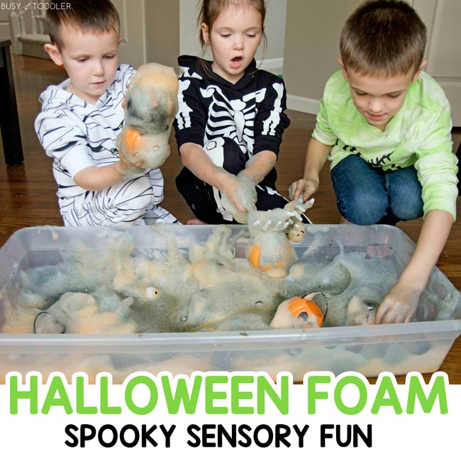 HALLOWEEN BUBBLE FOAM: You've got to try this Halloween Foam activity! Such a fun Halloween sensory experience that kids will LOVE! It's a quick and easy Halloween activity that's so easy to set up - Busy Toddler