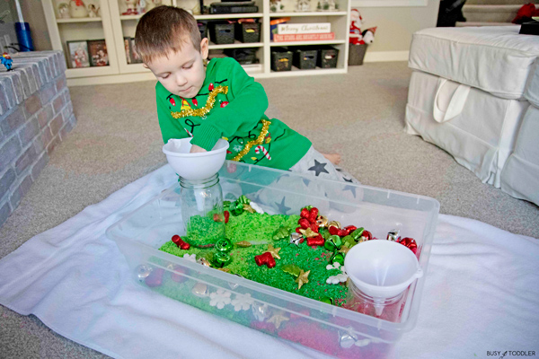 A Christmas sensory play activity from Busy Toddler using red and green dyed rice