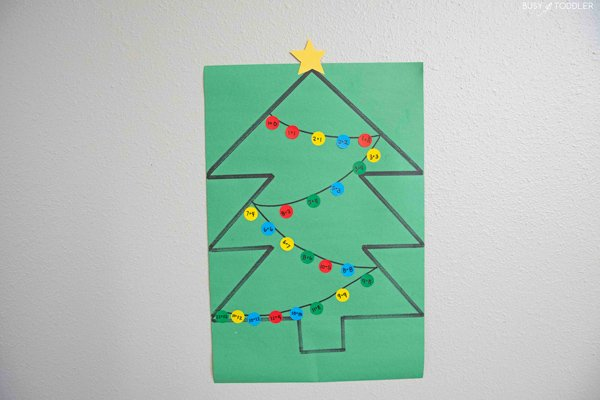 Child doing a Christmas math activity identifying addition facts and their sums to 24