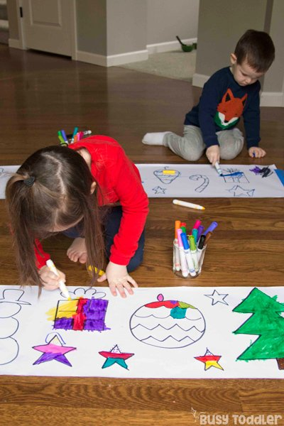 Kids coloring a Christmas art activity for toddlers and preschoolers