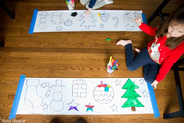Kids doing a Christmas Art activity - coloring large hand-drawn items