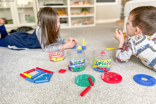 Kids playing with the Fill It Up! Fine Motor Jars from Lakeshore Learning
