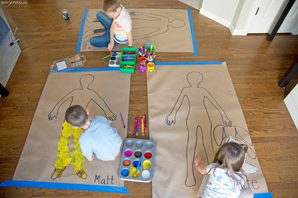 Kids painting in an easy indoor kids activity.