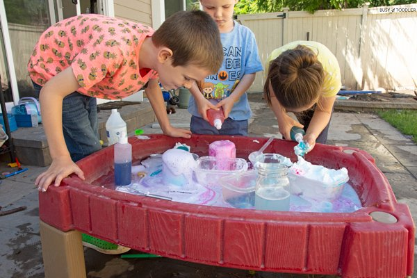 Kids playing at an outdoor science station