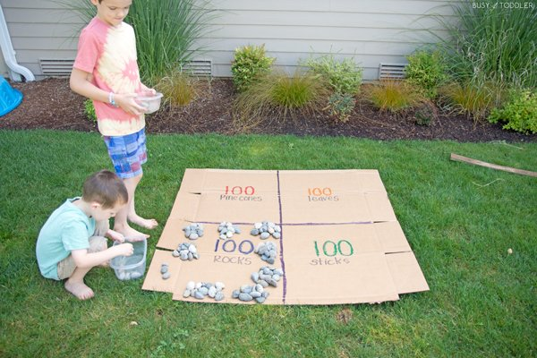 Kids learning about 100 with an outdoor math activity