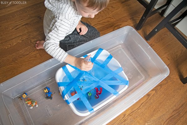 A preschooler rescuing the pups in a fine motor activity from Busy Toddler