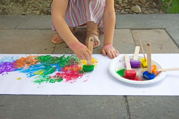 A child using frozen paint in a process art summer activity