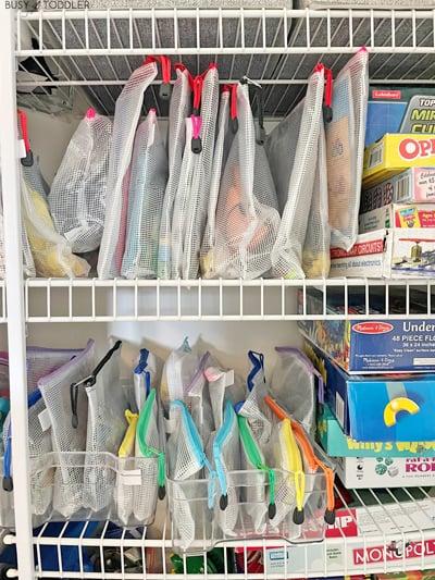An organized game closet with zipper pouches